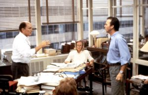 """Michael Keaton and Robert Duvall play editors arguing out in a """"budget meeting"""" in the movie The Paper. THE PAPER, Robert Duvall, Glenn Close, Michael Keaton, 1994, (c)Universal Pictures"""